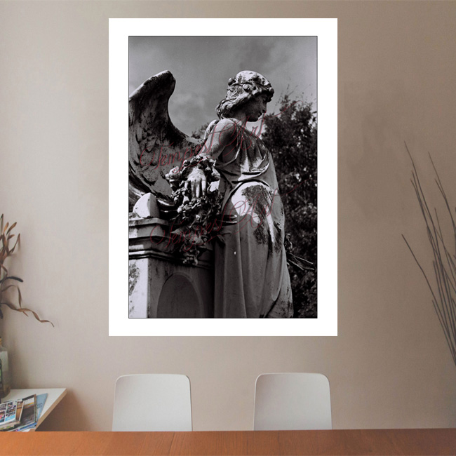 Swag A statue of an angel statue with wings standing sideways by a tomb in one of New Orlean's cemeteries NOLA Photography Office Art Print Tempest Art