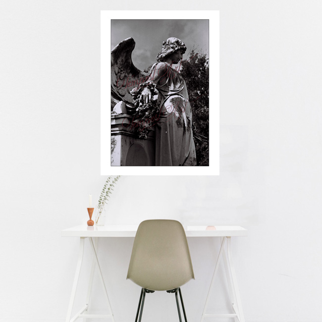Swag A statue of an angel statue with wings standing sideways by a tomb in one of New Orlean's cemeteries NOLA Photography Home Art Print Tempest Art